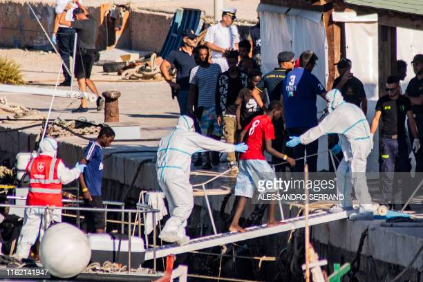 TOPSHOT One of the twentyseven unaccompanied minors aboard the Guardia di Finanza boat arrive at Italian island of Lampedusa on August 17 2019 after...