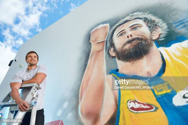 One of the two artists Jacob Butler poses in front his Josh Kennedy 2018 Mural commissioned by Seven West Media and the West Australian Newspaper in...