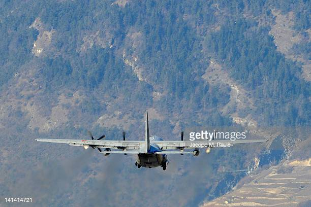 One of the two military C130 planes flies out of Sion airport carrying home the bodies of those killed in the Swiss bus crash on March 16 2012 in...
