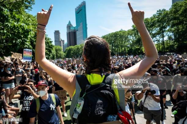 One of the Unite NY 2020 organizers Elizabeth Vargas holds up her hands to the thousands of protesters gathered on the lawn in Cadman Plaza, Brooklyn...