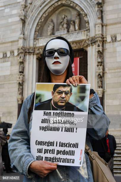 One of the victims of sexual abuse by priests accused of pedophilia protest masked in front of the cathedral of Naples They demand justice from...