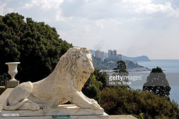 One of the white marble lions flanking the steps of the southern facade of Vorontsov Palace 18281846 designed by Edward Blore Alupka near Yalta...