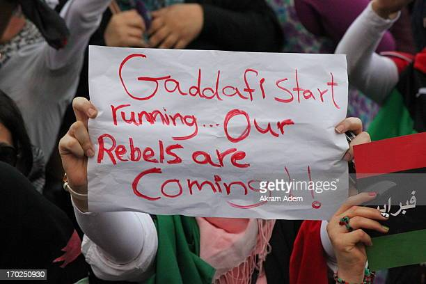 """One of the woman who participated in the demonstration, wrote this banner"""" Gaddafi start running, our Rebels are coming!! Demonstration in Martyr..."""