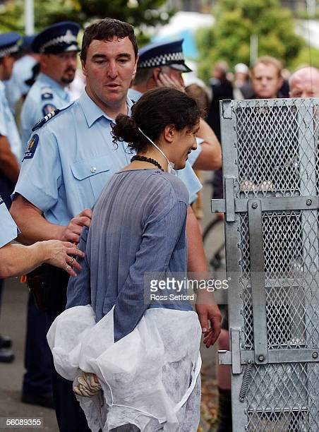One of the women protesters from the NZ Citizen Weapon Inspection Team is put in the police van outside the American Embassy SundayThe group were...