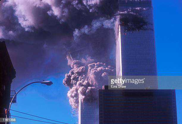 One of the World Trade Center's twin towers collapses after it was struck by a commerical airliner in a suspected terrorist attack September 11, 2001...