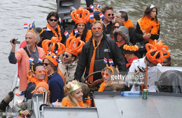 One of the Worlds biggest street parties takes place today as Holland celebrates Queensday The canals and streets of Amsterdam are packed as tens of...