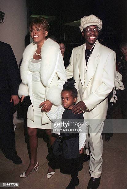 One of the world's most popular US singer Whiteny Houston her husband US singer Bobby Brown and their daughter Christina arrive 11 October 1998 at...