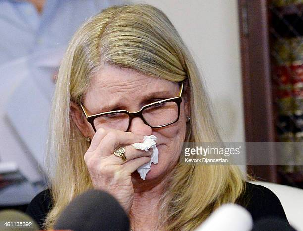 One of three alleged victims of sexual abuse by comedian Bill Cosby Linda Kirkpatrick reacts during a news conference with attorney Gloria Allred...