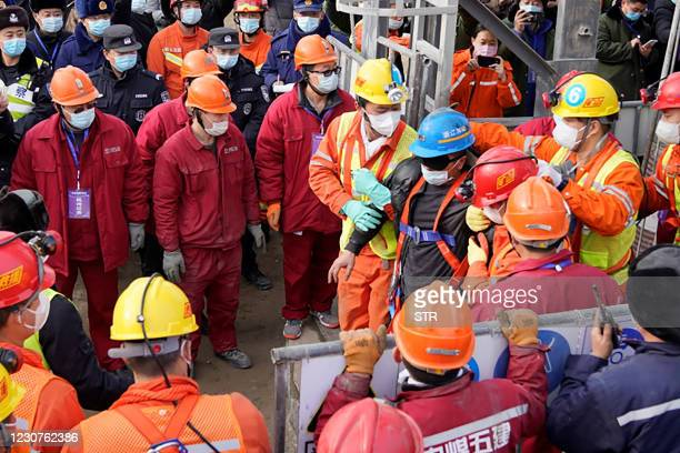 One of twenty-two Chinese miners is saved from hundreds of metres underground where they had been trapped for two weeks after a gold mine explosion...