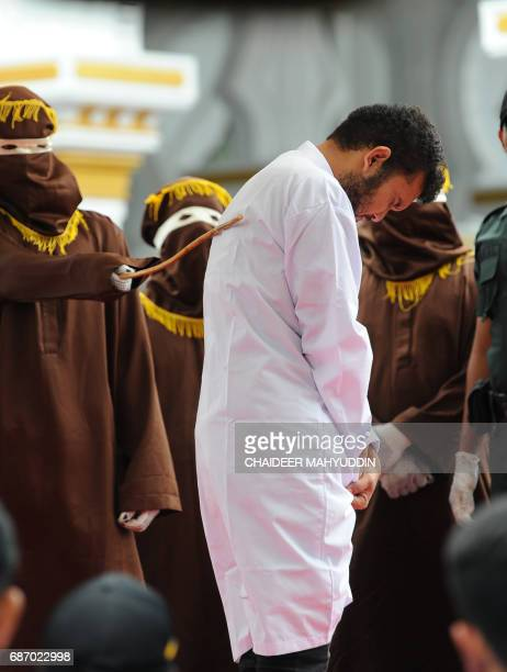 One of two Indonesian men is publicly caned for having sex in a first for the Muslimmajority country where there are concerns over mounting hostility...