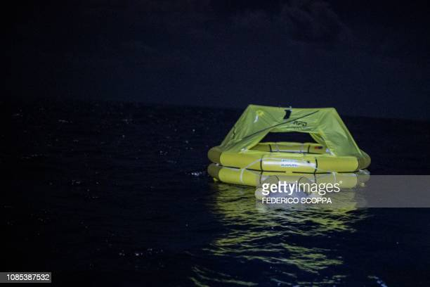 One of two life rafts dropped by an Italian navy airplane to survivors of an inflatable boat that capsized is pictured from the Dutchflagged rescue...