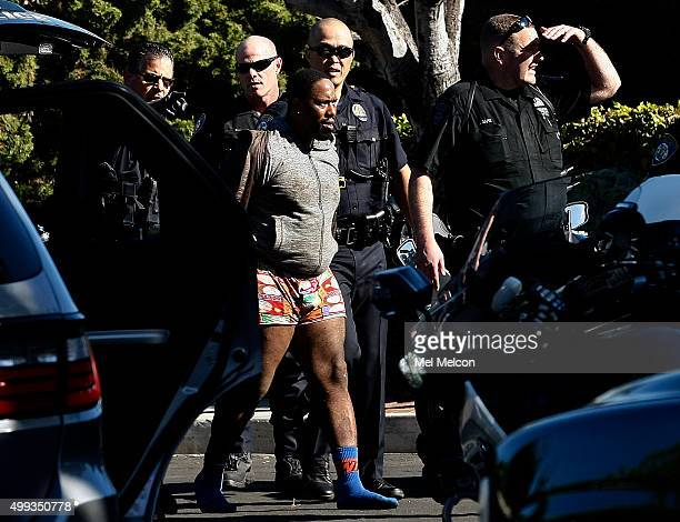 One of two suspects who led police on a car chase that started in Beverly Hills is taken into custody by Beverly Hills police officers after being...