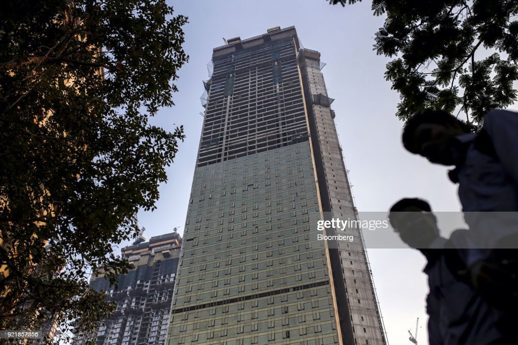 One of two towers of Trump Tower Mumbai, center, stands under construction at Lodha The Park, a luxury residential project developed by Lodha Developers Ltd., in Mumbai, India, on Tuesday, Feb. 20, 2018. India has the most construction projects with Trump licensing deals of any country outside of the U.S. Photographer: Dhiraj Singh/Bloomberg via Getty Images