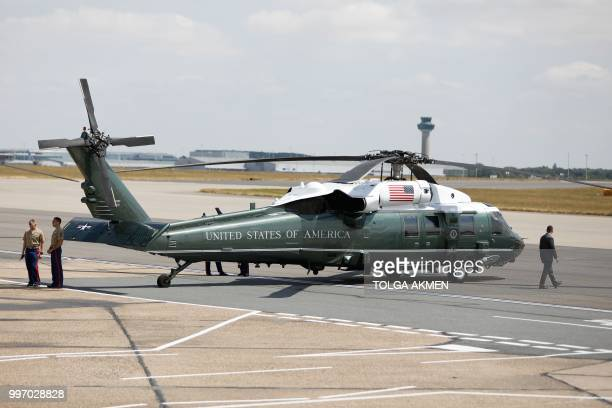 One of two US military helicopters sits on the tarmac at Stansted Airport north of London on July 12 ahead of the arrival of US President Donald...