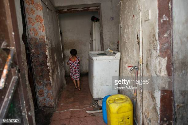 One of Yayeh Mussawa's 12 children is seen walking through the dilapidated hallway of their rented home in a neighborhood in south Riyadh Saudi...