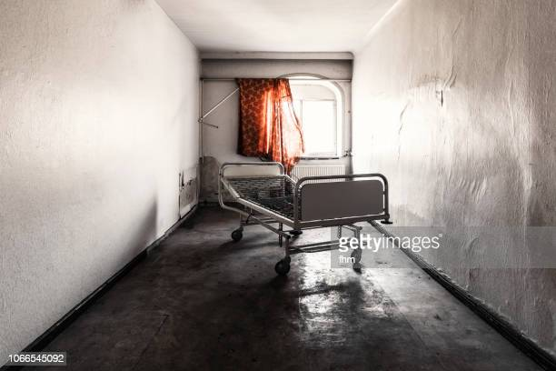 one old bed in a room in an abandoned hospital - abandoned stock pictures, royalty-free photos & images
