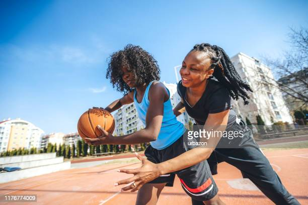 one on one basketball - women's basketball stock pictures, royalty-free photos & images