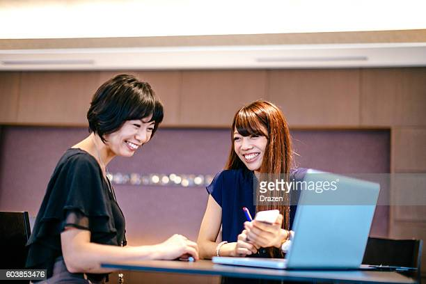 one on one meeting in japanese company - mission statement stock photos and pictures