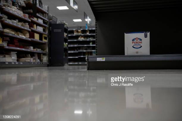 One pack of Peroni beer remains on the shelves inside a Waitrose supermarket as the outbreak of coronavirus intensifies on March 25 2020 in Chipping...
