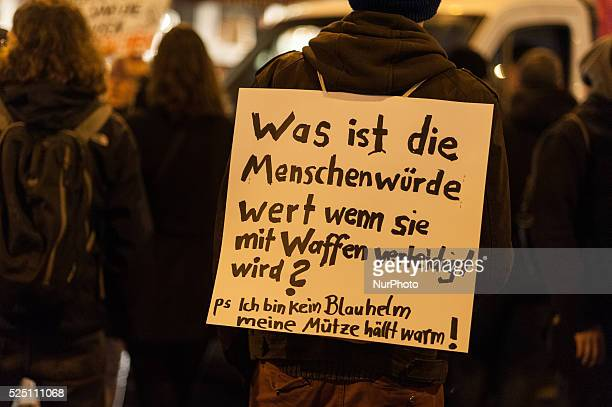 One participant Germany slung a shield during the demonstration against the curfew on in Berlin Approximately 200 participants attended the...