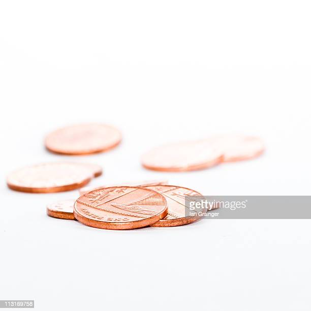 one pence coins - ian grainger stock pictures, royalty-free photos & images