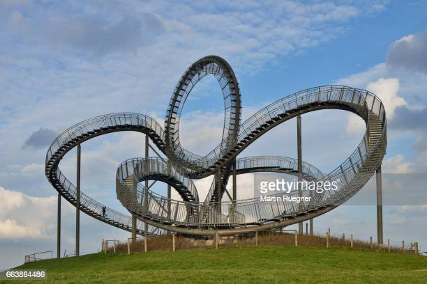one person on tiger and turtle - magic mountain. - duisburg imagens e fotografias de stock