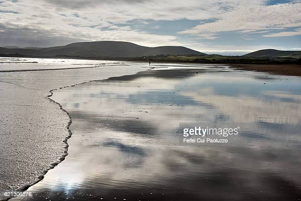 One person walking on the beach of Waterville in Ireland