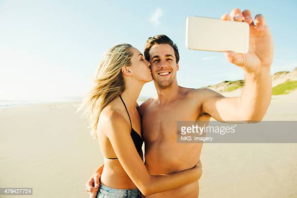 one picture, a thousand memories - muscle men at beach stock photos and pictures