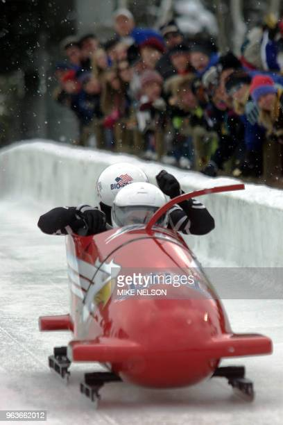 USA One pilot Todd Hays and teammate Pavle Jovanovic are cheered by spectators during the start of the twoman bobsleigh World Cup competition number...