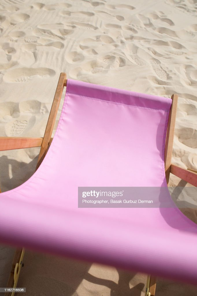 One pink lounge chair on sand in summer : Stock Photo