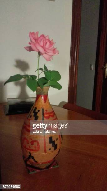 One pink rose in a vase at home