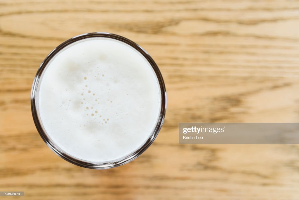 One pint of beer on wooden counter : Stock Photo