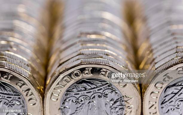 one pound coins - new stock pictures, royalty-free photos & images
