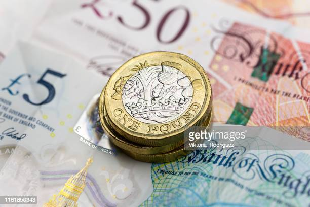 one pound coins - saving stock pictures, royalty-free photos & images