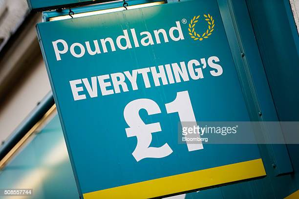A one pound sterling sign hangs outside a Poundland Group Plc store in Leigh UK on Thursday Feb 4 2016 UK like for like sales at midmarket retailers...