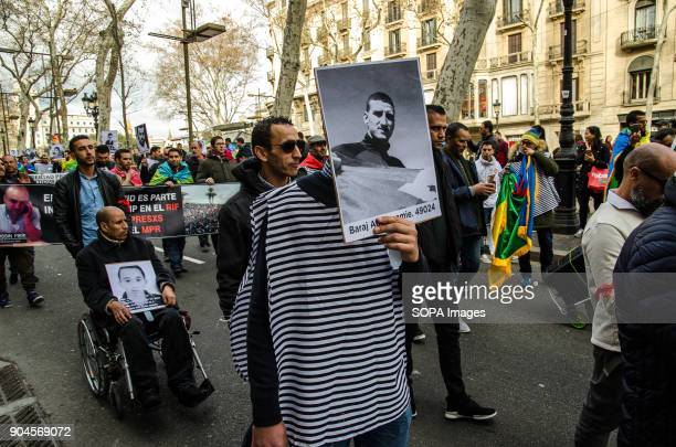 One protester seen displaying a poster with a picture of a prisoner during the march Third March in Barcelona by the resistance freedom and justice...