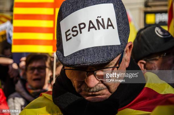 One protester seen displaying a sticker pasted on his cap with the text 'Spain'Spain celebrates today the 39 anniversary of its Constitution This...