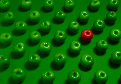 One red apple with many green apples - gettyimageskorea