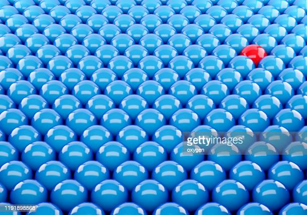 one red sphere amidst blue another. different unique leadership sphere success business. 3d render - individuality stock pictures, royalty-free photos & images