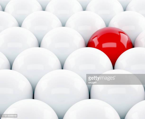 one red sphere amidst white another. different unique leadership sphere success business. 3d render - individuality stock pictures, royalty-free photos & images