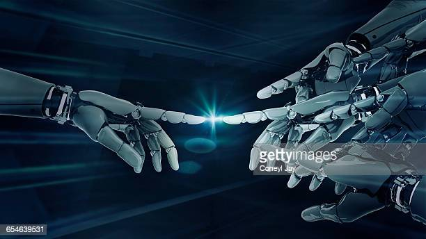 one robot hand pointing energy to many - coneyl stock pictures, royalty-free photos & images
