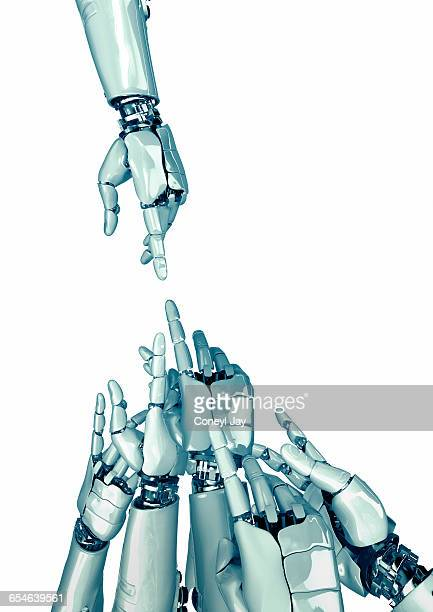 one robot hand pointing to many - coneyl stock pictures, royalty-free photos & images