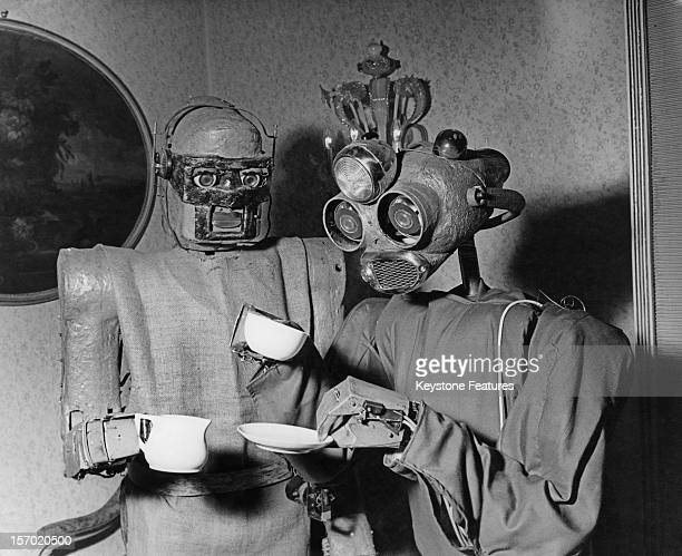 One robot serves coffee to another Vienna October 1964 The machines were designed by Viennese artist Claus Scholz