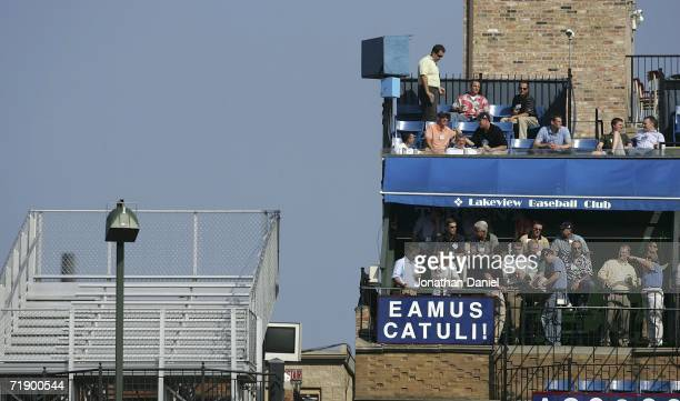 One roof top deck on Sheffield Avenue is empty and one has fans during a game between the Chicago Cubs and the Cincinnati Reds on September 15 2006...