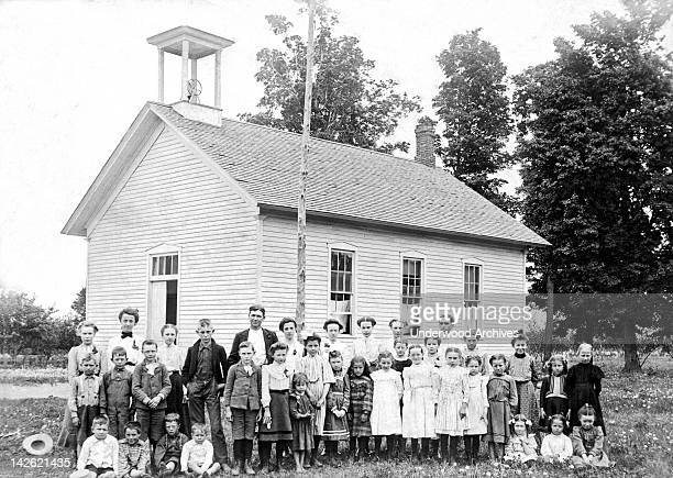 A one room school house with the children of all ages Grand Junction Michigan late 1880s or early 1890s