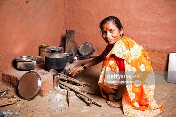 One Rural Indian Woman preparing food Horizontal