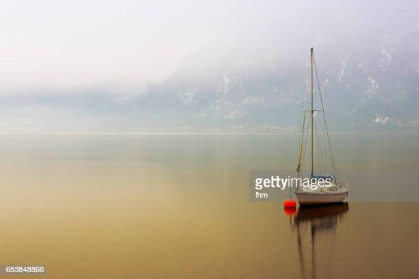 One sailboat on a lake in the mountains (Alps, Austria)