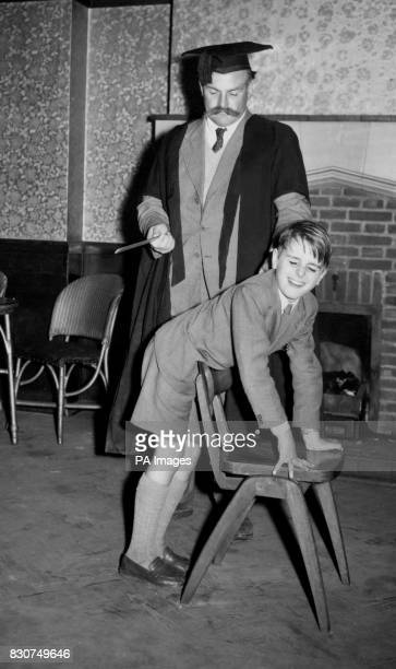 One schoolmaster who retains a belief in corporal punishment is Professor Jimmy Edwards seen administering some correction with a ruler to David...