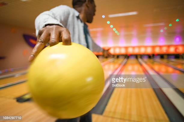 one senior man ten pin bowling - bowling stock pictures, royalty-free photos & images