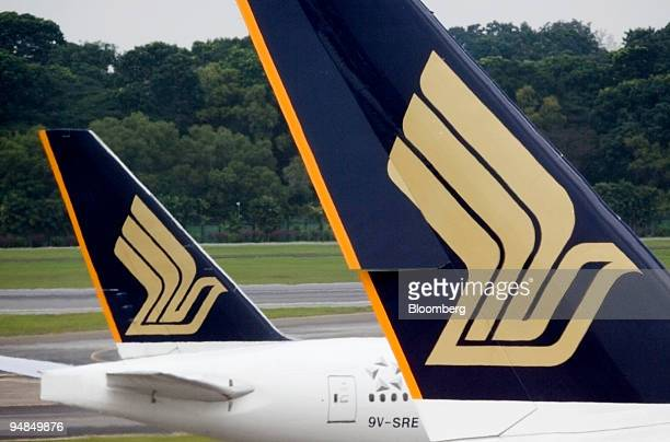 One Singapore Airlines Ltd jet moves past another on the runway at Changi airport in Singapore on Thursday Nov 6 2008 Singapore Airlines Ltd Asia's...